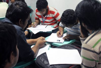 Students of AIUB is drawing sketches of a mobile applicaiton