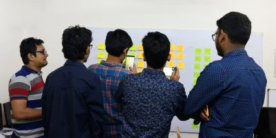 UX Design students in doing card sorting in a brain storming session